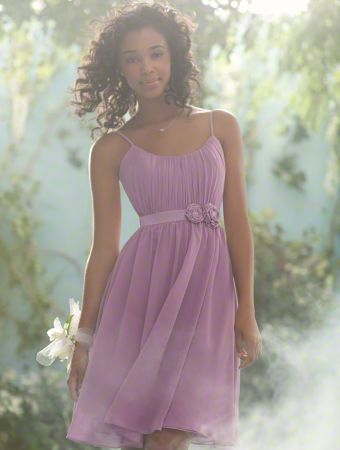A Beautiful Bridesmaid Wearing A Purple, Cocktail Length Princess Bridesmaid Dress With Beading And Flowers At The Waist